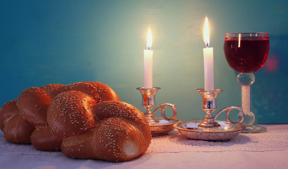 shabbat image. challah bread, shabbat wine and candelas