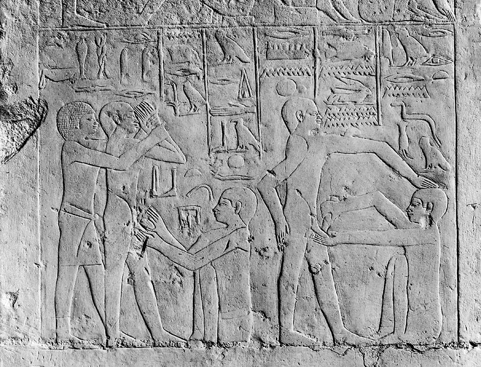 M0005235 Egypt, wall carving showing a circumcision scene, Sakkara Credit: Wellcome Library, London. Wellcome Images images@wellcome.ac.uk http://wellcomeimages.org Wall carving showing a circumcision scene, Sakkara, Egypt. Cast in the Wellcome Historical Medical Museum Published:  -  Copyrighted work available under Creative Commons Attribution only licence CC BY 4.0 http://creativecommons.org/licenses/by/4.0/