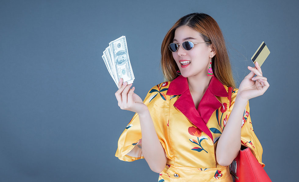 Women holding smart cards and money.