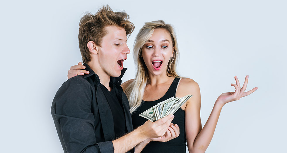 Happy couple show dollar banknote make some business