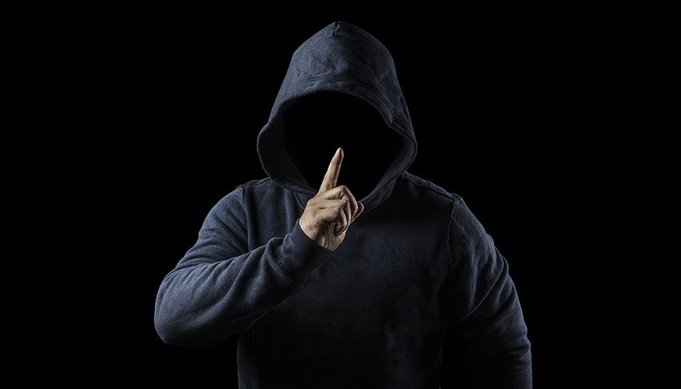 Mysterious, unknown person in the hood. Danger in darkness. anon