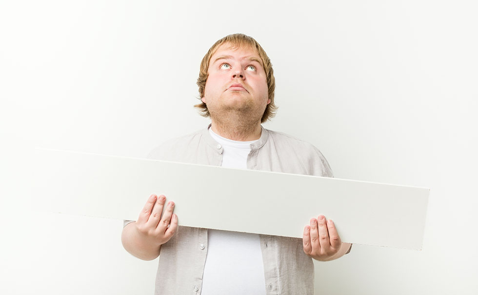 Caucasian crazy blond fat man with a placard