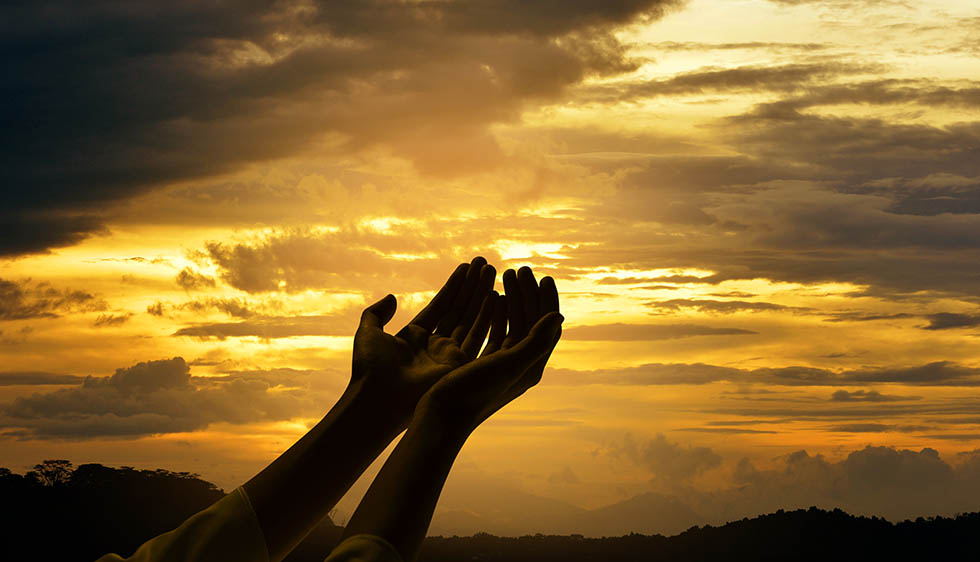 Male hands with open palm praying to god