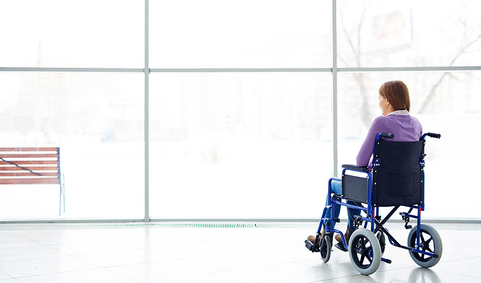 Disabled woman looking at window