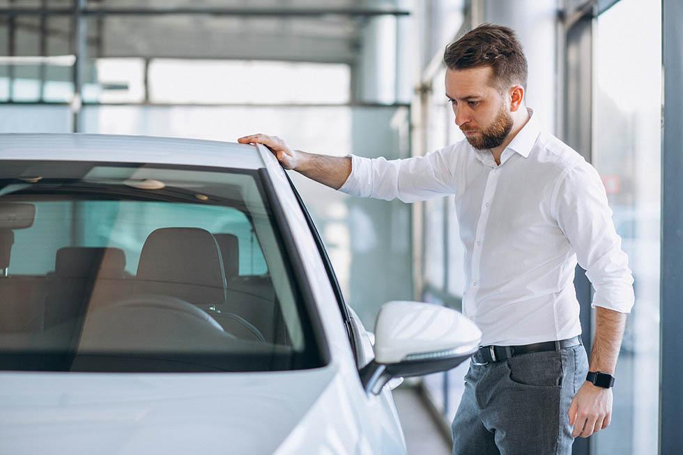 Salesman at a car showroom