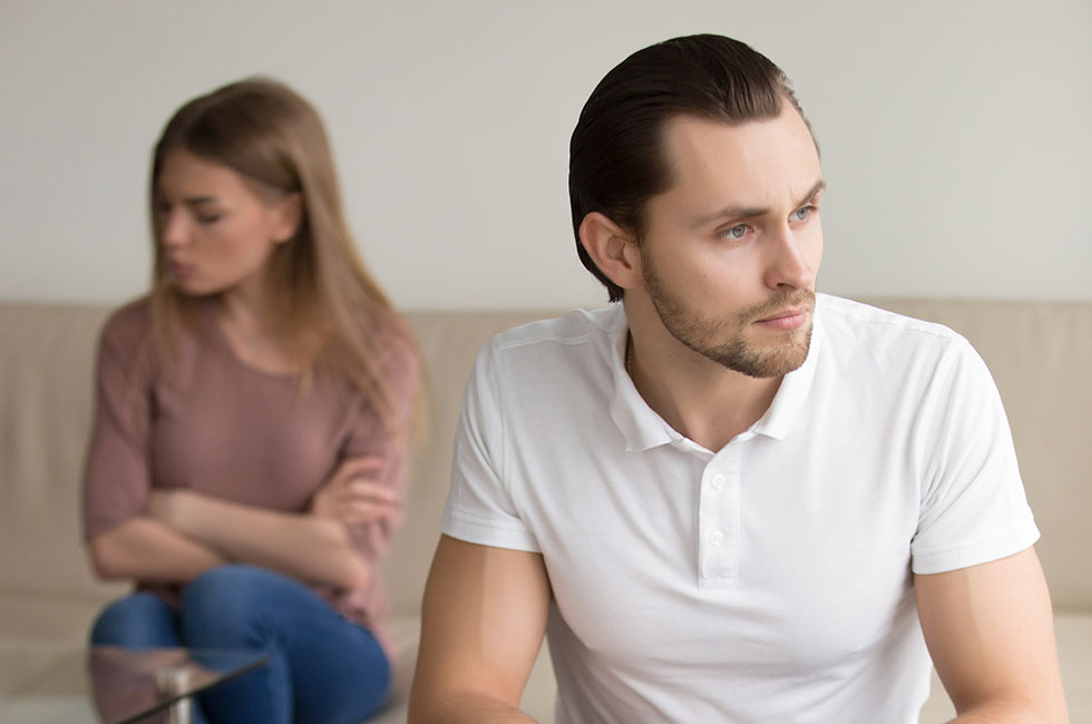 Sad frustrated couple after fight, serious man thinking of break