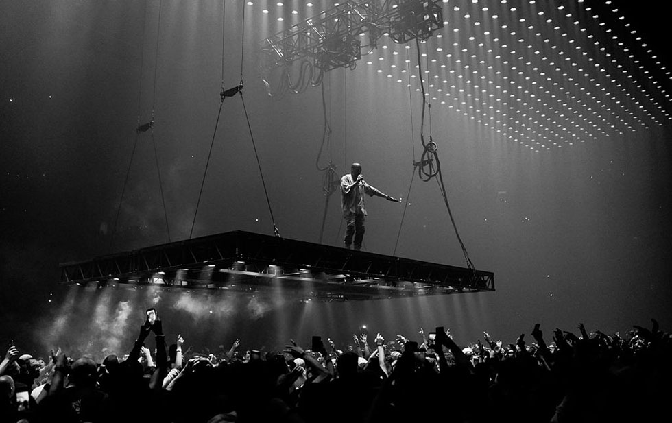 photo - Kenny Sun. West performing on the Saint Pablo Tour in 2016